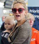 Kate Hudson carries her son Bingham through the airport in Toronto, Canada on September 10, 2012.