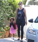 Heidi Klum picks up her daughter Lou from school on September 19, 2012 in Brentwood, California.