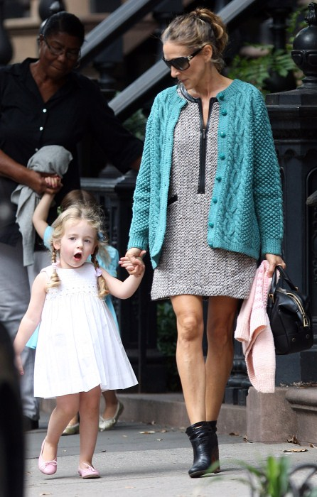 Sarah Jessica Parker helps her daughters Marion and Tabitha into a car in New York City, NY on September 16th, 2012.