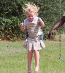 Reality TV star Alana Thompson aka 'Honey Boo Boo' wears heels while swinging at the with her sisters Jessica