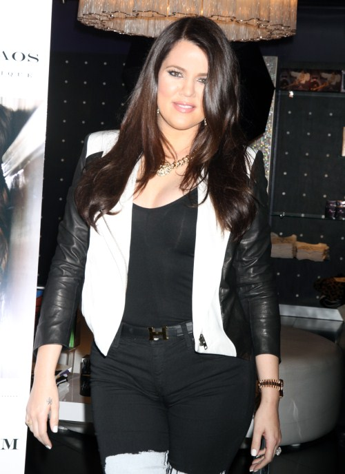 "Khloe Kardashian makes a solo appearance at Kardashian Khaos for a fan meet-and-greet opportunity supporting her and husband Lamar Odom's perfume ""UnbreakableÓ at the Mirage Hotel & Casino in Las Vegas, Nevada on August 24, 2012. Khloe even stops to spray ""Unbreakable"" on herself."