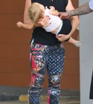 Pink, her husband Carey Hart and their daughter Willow out for a stroll in New York City, New York on September 17, 2012.