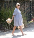 Reese Witherspoon looks ready to burst as she leaves her therapist's office in Brentwood, California on September 17, 2012.