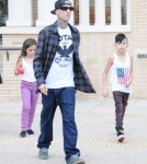 Musician Travis Barker and his kids Alabama and Landon out shopping at Barneys New York in Beverly Hills, California on September 5, 2012.