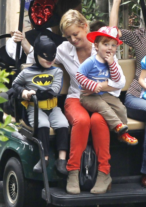 Amy Poehler takes her sons Archie and Abel to a costume party in Beverly Hills, California on October 20, 2012. Archie was dressed up as Batman and Abel was a fireman