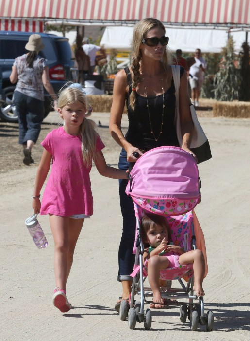 enise Richards takes her daughters Lola, Sam, and Eloise to a pumpkin patch in Simi Valley, CA for a day of harvest fun on October 1st, 2012.