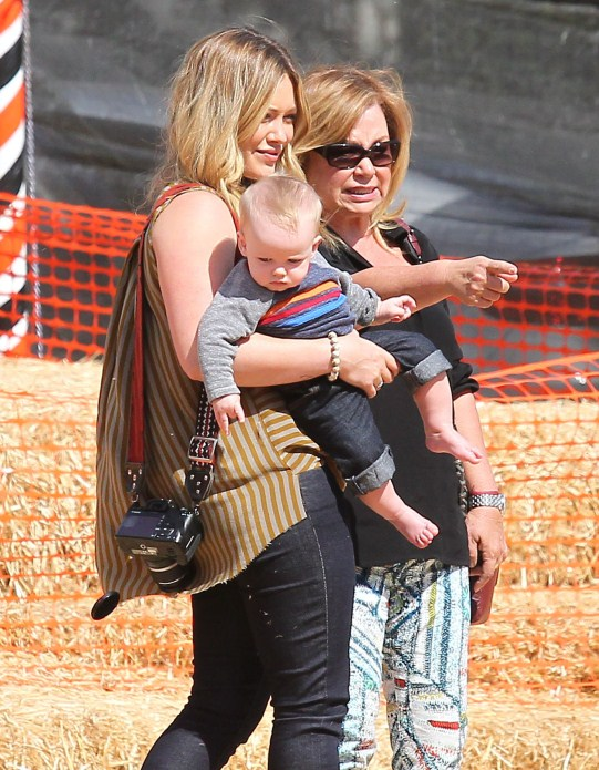 Actress Hilary Duff and husband Mike Comrie take their son Luca to the Mr. Bones Pumpkin Patch in West Hollywood, California on October 13, 2012.