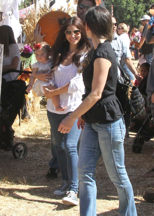 Roselyn Sanchez and husband Eric Winter take their daughter Sebella to the Mr. Bones Pumpkin Patch in West Hollywood, California on October 14, 2012.