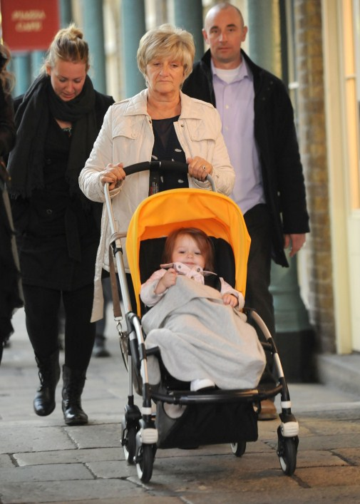 Harper Seven Beckham and David Beckham's mother Sandra Georgina West are spotted out on a stroll in Covent Garden on October 15, 2012 in London, England.