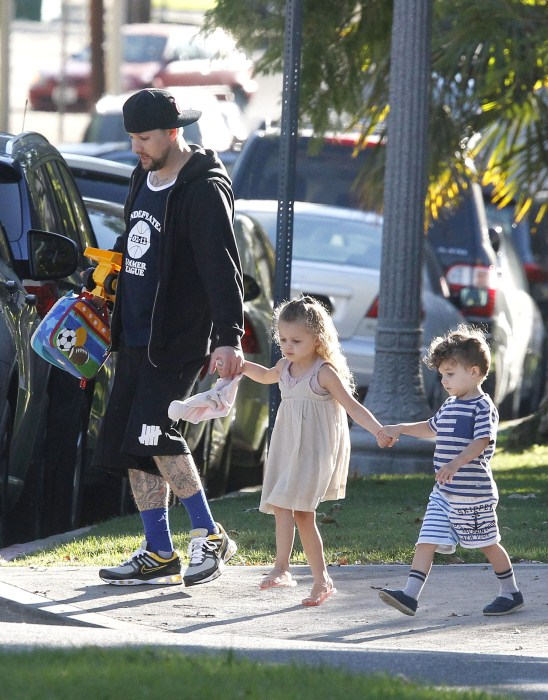 Good Charlotte singer Joel Madden tackles daddy duties as he walks his daughter Harlow and son Sparrow to school on October 15, 2012 in Los Angeles, California.