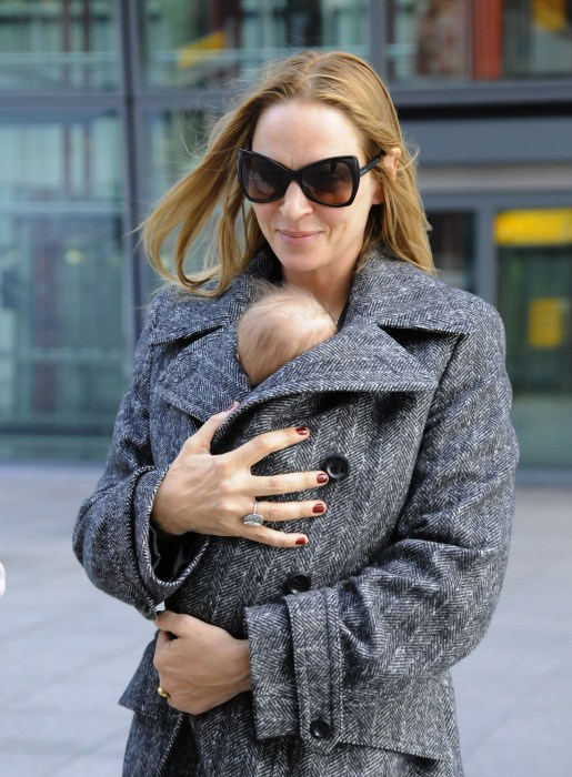 Uma Thurman and Rosalind Luna arrive at Heathrow Airport from Los Angeles on October 17, 2012 in London, England.