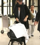 Molly Sims and Son Brooks Arrive at LAX