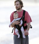 Eric Johnson Takes Maxwell On A Sunrise Walk On The Beach