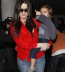 Khloe & Kourtney Kardashian Land At LAX