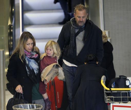 Kevin Costner & Family Arrive In Paris