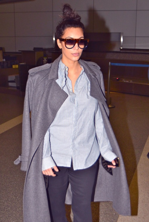 Pregnant Kim Kardashian Arriving On A Flight At LAX