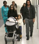 Kourtney Kardashian And Family Arriving On A Flight At LAX