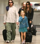 Christian Bale And Family Arriving On A Flight At LAX