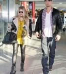 Pregnant Fergie & Josh Land In London