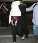 Shy Adele And Family Departing On A Flight At LAX