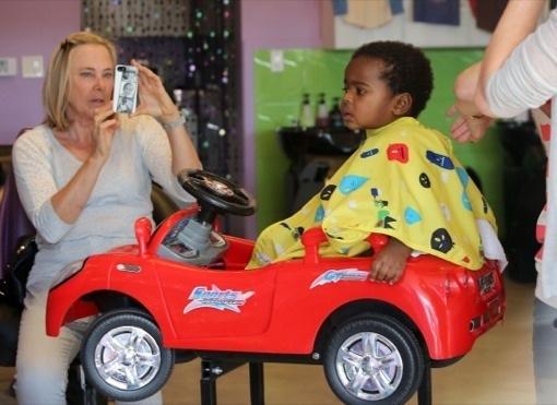 Charlize Theron Takes Jackson For a Rockin' Trim