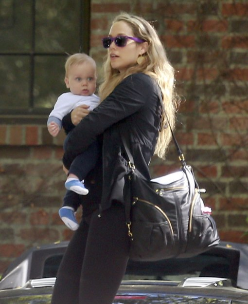 Elizabeth Berkley Holds Sky Close