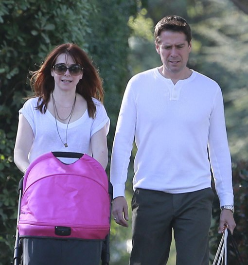 Alyson Hannigan And Her Husband Take Their Daughter For A Stroll