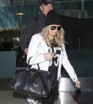 Fergie & Josh Duhamel Land At LAX Airport
