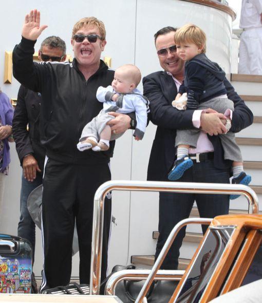 Elton John & Family Arrive In Venice