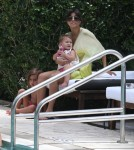Kourtney Kardashian & Family Relaxing Poolside In Miami