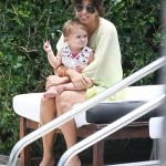 Kourtney Kardashian Relaxes Poolside With Family