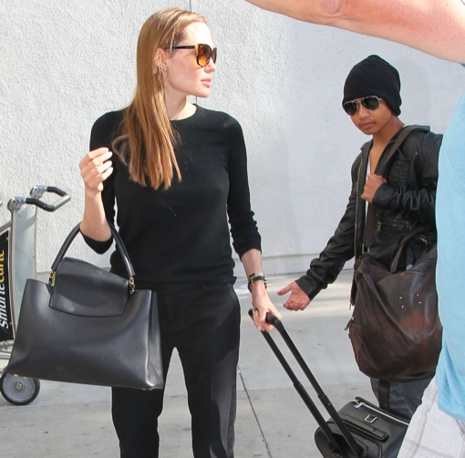 Angelina Jolie Touches Down With Maddox