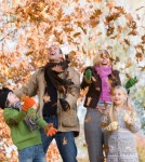 Family throwing leaves in the air