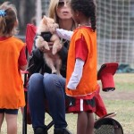 Heidi Klum Cheers On Her Children While Doting on Their Family Dog