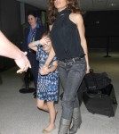 Salma Hayek & Daughter Arrive On A Flight AT LAX