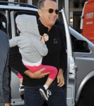 Tom Hanks Holds His Grandson Close