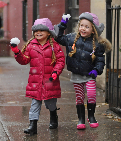 Marion & Tabitha Broderick Play With Snow On Their Way To School