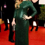 Olivia Wilde Bumps the Golden Globes Red Carpet in a Emerald Green Gown