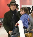 Orlando Bloom & Son Flynn Arriving On A Flight At LAX