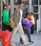 Brad Pitt, Angelina Jolie & The Kids Land At LAX Airport