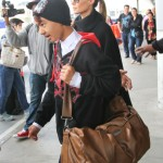 Angelina Jolie & Brad Pitt Return Home With Maddox From London