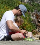 Chris Hemsworth Enjoys A Day At The Beach With His Daughter
