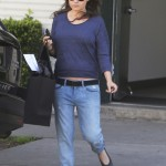 Mila Kunis Debuts Baby Bump
