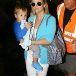 Reese Witherspoon & Her Sons Touch Down in Miami