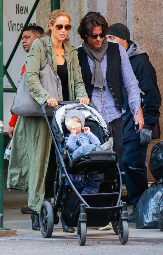 Elizabeth Berkley Strolls With Family in the Big Apple