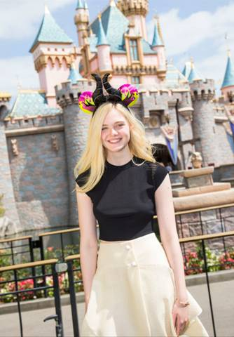 Elle Fanning Visit's Sleeping Beauty's Castle