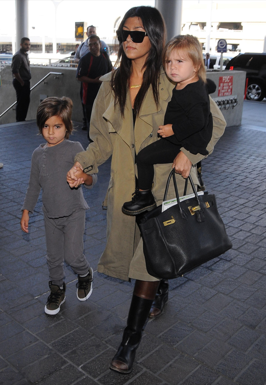 Kourtney Kardashian & Kids Departing On A Flight At LAX