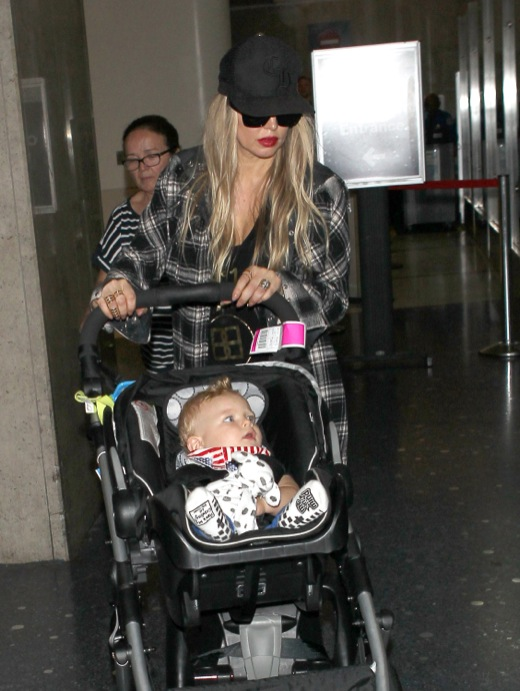 Fergie & Josh Duhamel Touch Down At LAX