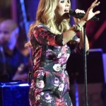 Carrie Underwood Debuts Tiny Baby Bump at Concert