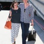 Pregnant Milla Jovovich Touches Down